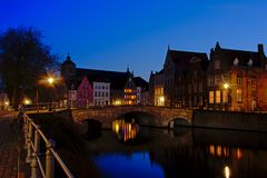 Night view on a canal with historical houses in Bruges. Canal with bridge and raditional  houses in the historic centre of the city of Bruges, Flanders, Belgium Royalty Free Stock Image