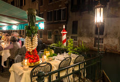 Night view of canal and restaurant in Venice Royalty Free Stock Photo