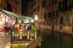 Night view of canal and restaurant in Venice Royalty Free Stock Images