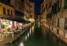Night view of canal and restaurant in Venice Royalty Free Stock Photography