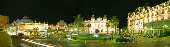 The night view of Casino Square of Monte Carlo. MONACO - FEBRUARY 20, 2012: Panorama of Casino Square in Monte Carlo with luxury palaces and mansions around the stock photo