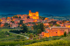 Night view of castle and roofs. Of houses in the tranquility of a medieval village in the hills of Romagna in Italy stock images