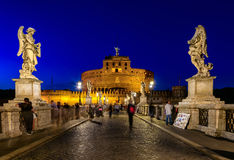 Night view of Castle Sant Angelo Mausoleum of Hadrian, bridge Sant Angelo and river Tiber in Roma Stock Image