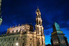 Illluminated Katholische Hofkirche in Dresden. Night view of the Cathedral of the Holy Trinity Hofkirche in Dresden, as seen from Schlossplatz square. Long Royalty Free Stock Images