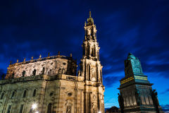 Illluminated Katholische Hofkirche in Dresden. Night view of the Cathedral of the Holy Trinity Hofkirche in Dresden, as seen from Schlossplatz square. Long Royalty Free Stock Image