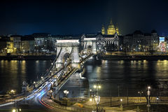 Night view of Chain Bridge and St. Stephen`s Basilica in Budapest Royalty Free Stock Photo