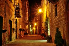 Night view of a characteristic narrow street in Pienza, Tuscany, Italy Royalty Free Stock Image