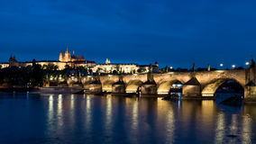 Night view of Charles Bridge and San Vito cathedral, Prague Royalty Free Stock Images