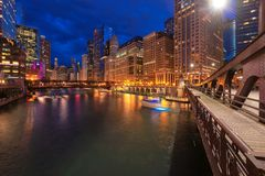Chicago downtown and Chicago River at night in Chicago, Illinois royalty free stock photo