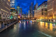 Chicago downtown and Chicago River at night in Chicago, Illinois stock photos