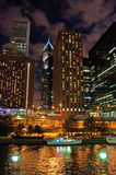 Night view of Chicago skyline with canal cruise on the river Royalty Free Stock Photo