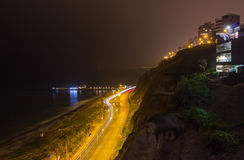 Night view of the Chorrillos Bay in Lima, Peru. Panoramic night shot of the costa verde freeway Stock Photography