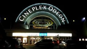 Night view of cineplex odeon theater stock footage
