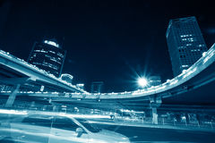 Night view of the city. The light trails on the modern building background in beijing china Stock Images
