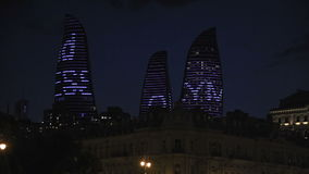 Night view of city with Flame Towers. Baku stock video footage