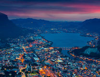 Night view of the city Lecco  and Lake Garlate. Stock Image