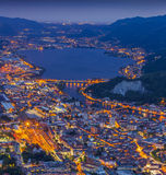 Night view of the city Lecco and Lake Garlate. Alps, Italy Royalty Free Stock Image