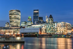 Night view of City of London with copy space in clear sky. London, United Kingdom - January 2, 2015: Night view of City of London across river Thames as seen on Royalty Free Stock Image