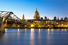 Night view of city of London  over river Thames. View of St. Paul's Cathedral and the Millennium Bridge in London over river  Thames Stock Photography