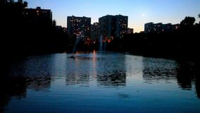 Night view of a city with reflection in water. Moscow. Russia stock video footage