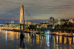 Night view of a city by a river Royalty Free Stock Image