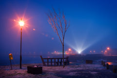 Night view of city river in winter fog Royalty Free Stock Photo