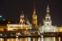 Night view of the city with royal palace buildings and reflections in the Elbe river in Dresden, Germany. Stock Photography