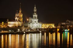 Night view of the city with royal palace buildings and reflections in the Elbe river in Dresden, Germany. Royalty Free Stock Photography
