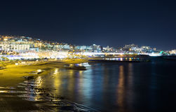 Night view of the city and the sea Stock Photos