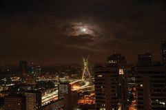 Night view of the city skyline with bridge and buildings under cloudy and full moon in the city of São Paulo. Stock Image