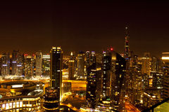 Night view of city skyline. View of Dubai city skyline at dusk with skyscrapers in the foreground Royalty Free Stock Image