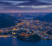 Night view of the cityValmadrera and lake Annone stock photo