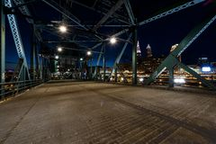 Cleveland, Ohio Skyline at Night - View from Abandoned Lift Bridge. A night view of the Cleveland, Ohio skyline from the road deck of the abandoned Eagle Street Stock Photography