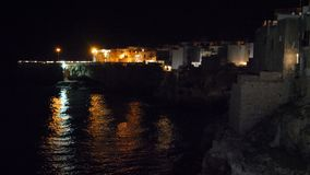 Night view of cliff and town of Polignano a Mare, Italy stock video