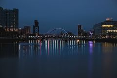Night view of the Clyde Arc. Or Squinty Bridge from the East and river Clyde, Glasgow, Scotland Royalty Free Stock Photography