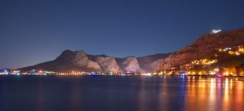 Night view of coastal town of Omis Stock Images