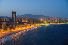 Night view of the coastline in Benidorm with city lights Stock Photos