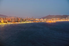 Night view of the coastline in Benidorm with city lights Stock Photography