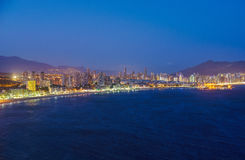 Night view of the coastline in Benidorm with city lights. Breathtaking night view of the coastline in Benidorm with high buildings, mountains, sea and city Stock Photos