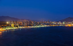 Night view of the coastline in Benidorm with city lights. Breathtaking night view of the coastline in Benidorm with high buildings, mountains, sea and city Royalty Free Stock Photos