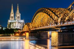 Night View Of Cologne Cathedral And Hohenzollern Royalty Free Stock Photos