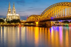Cologne Cathedral and Hohenzollern Bridge at night, Germany Stock Images