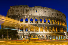Night view of Colosseum with traffic lights in Rome Stock Photo