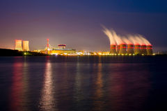 Night view of cooling towers of the Novovoronezh nuclear power plant from the co Stock Photos