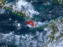 Night view of Costa Rica. Country of Costa Rica in red on planet Earth with clouds at night. 3D illustration. Elements of this image furnished by NASA Stock Photo
