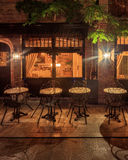 Night view of cozy restaurant in medieval old town of Bruges, Belgium. Illuminated restaurant in Bruges at rainy night. Glowing lights Royalty Free Stock Images