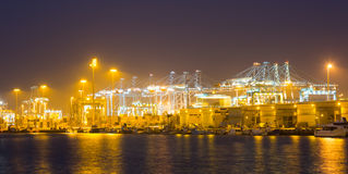 Night  view of   cranes and containers in cargo seaport Stock Images