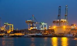 Night view of   cranes  in seaport. Algeciras Stock Photos