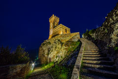 Night view of crenellated clock tower Stock Photos