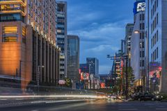 Night view of the crossing intersection of Hibiya Street and Harumi street at the entrance of the Hibiya Park (日比谷公園 Hi. Night view stock image